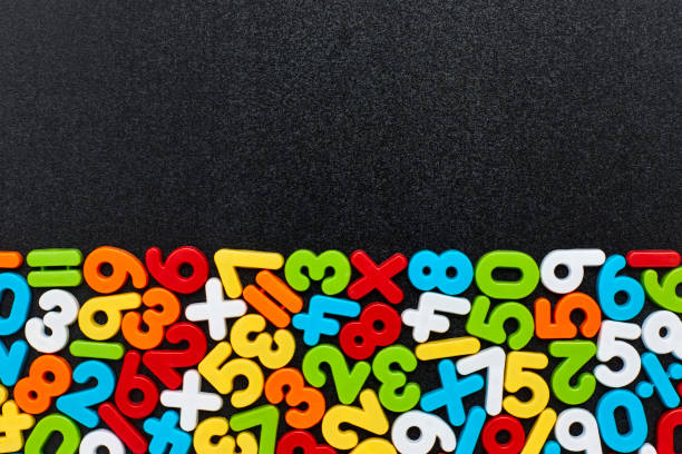 Overhead view of colorful mathematical symbols on blackboard stock photo