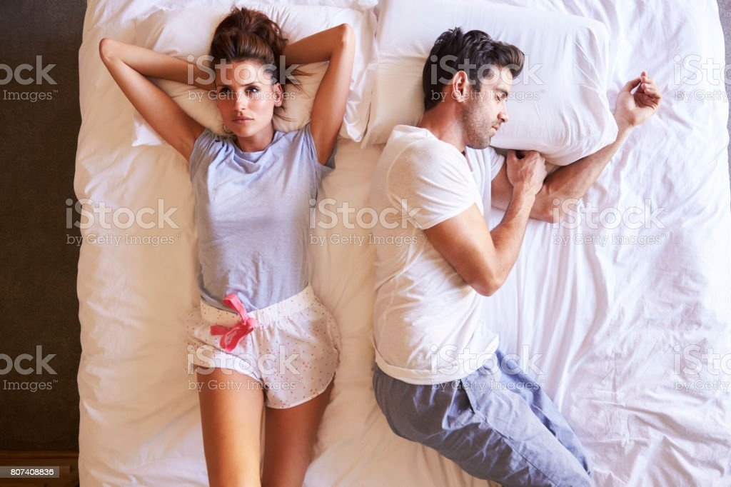 Overhead View Of Couple With Relationship Problems Lying In Bed - Royalty-free 30-39 Years Stock Photo