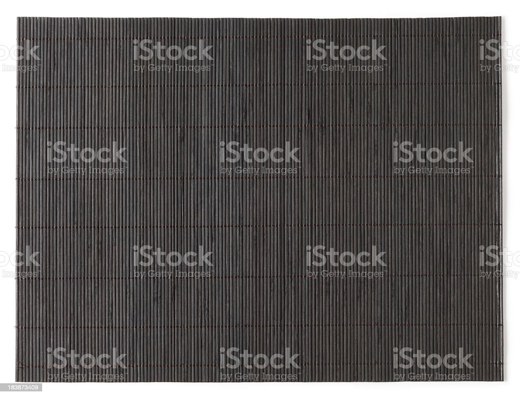 Overhead view of dark stained bamboo mat stock photo