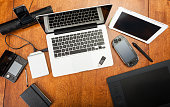istock Overhead View Of Electronic Devices On A Desk 469467260