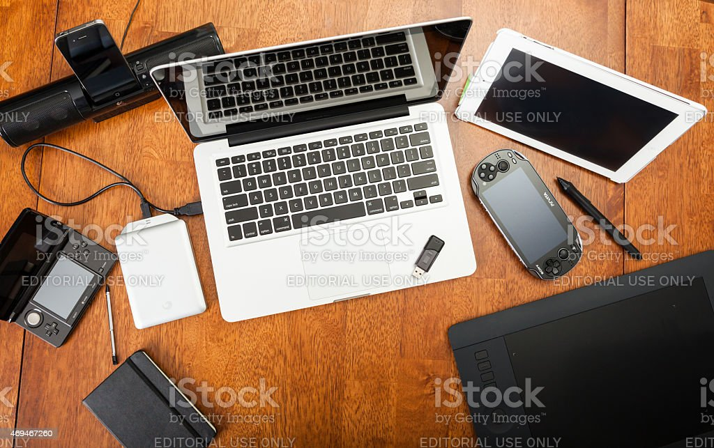 Overhead View Of Electronic Devices On A Desk stock photo