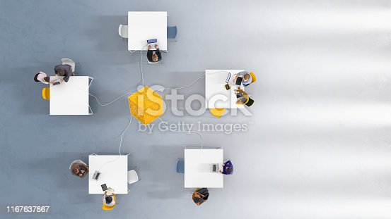 Overhead view of people at work, rectangular workstations arranged in a circle around a data cube