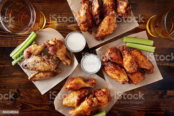 Overhead view of four different flavored chicken wings with beer picture id534048044?b=1&k=6&m=534048044&s=612x612&h=ln6brawfknvnm3vit3 3rdnt67mufeh6mbbz1h0lfe0=