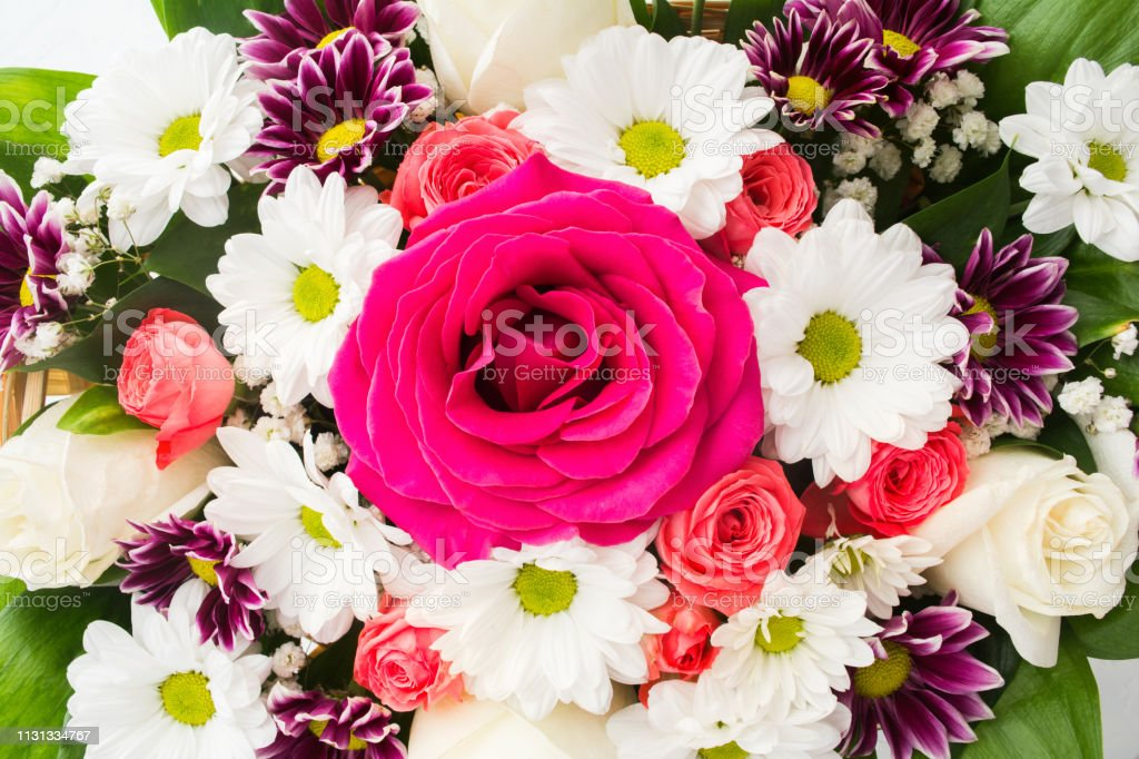Overhead view of fresh flowers bouquet with roses and camomile and...