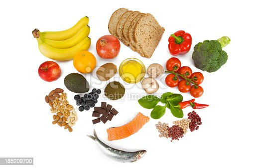 istock Overhead view of fresh food groups collectively known as Superfoods 185209700