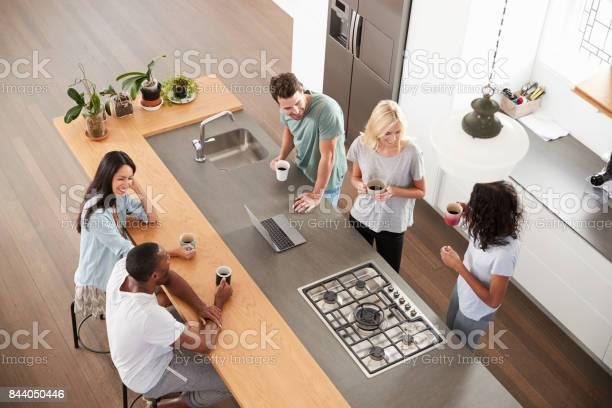 Overhead view of friends drinking coffee in modern kitchen picture id844050446?b=1&k=6&m=844050446&s=612x612&h=yknz2popzc vdqvjybimxnlday1zzcyhqugz2eljpls=
