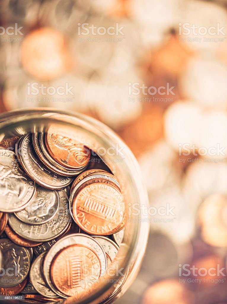 Overhead view of full American currency money jar. Savings concepts stock photo