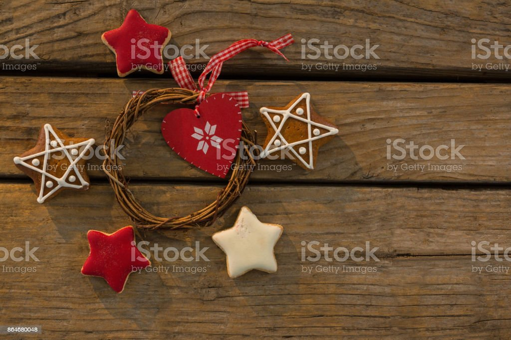 Overhead view of gingerbread cookies with Christmas decoration on table stock photo