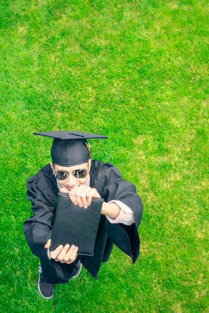 overhead view of graduate with diploma - sdominick stock pictures, royalty-free photos & images