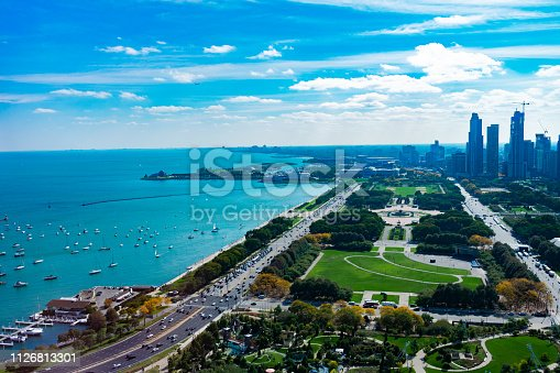 An aerial view of Grant Park, Lake Shore Drive, Lake Michigan and buildings in Chicago