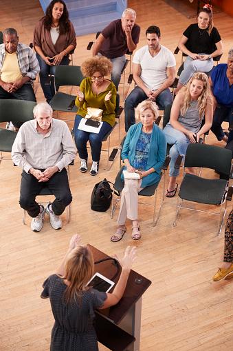 istock Overhead View Of Group Attending Neighborhood Meeting In Community Center 1145049680