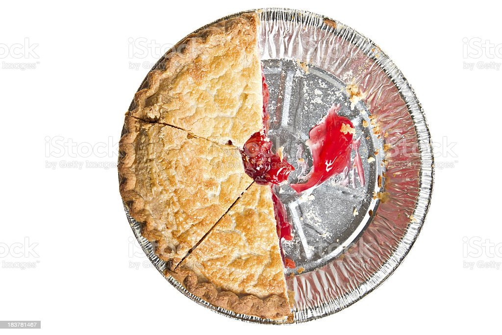 Overhead view of half of sliced cherry pie in pan stock photo