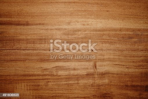 istock Overhead view of light brown wooden table 491606503