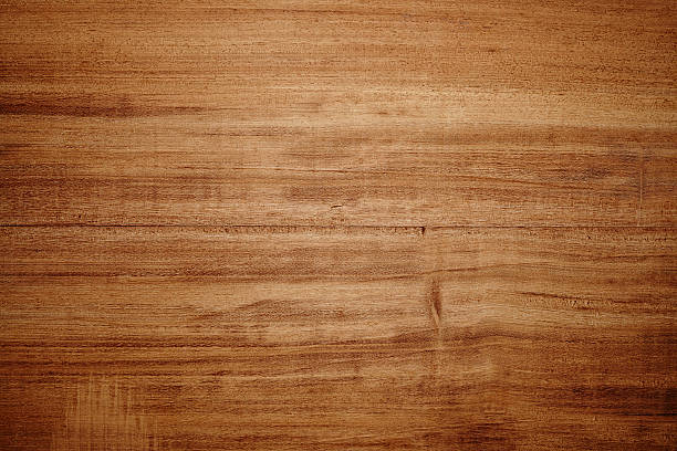 Overhead view of light brown wooden table stock photo