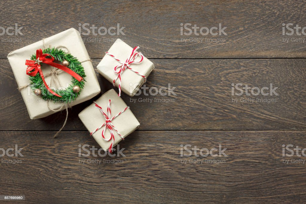 Overhead view of Merry Christmas decorations concept background.Mix accessories objects on modern rustic brown wooden at home office studio desk.Present is item of the season.free space for creative. stock photo