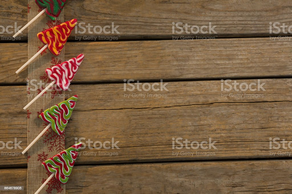 Overhead view of mint candies arranged on embroidered burlap stock photo