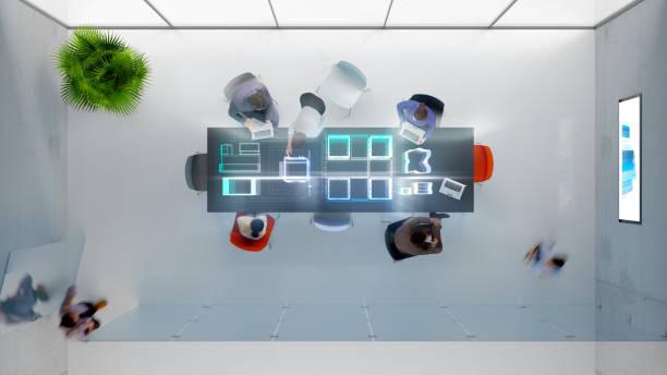 overhead view of modern office - business woman hologram imagens e fotografias de stock