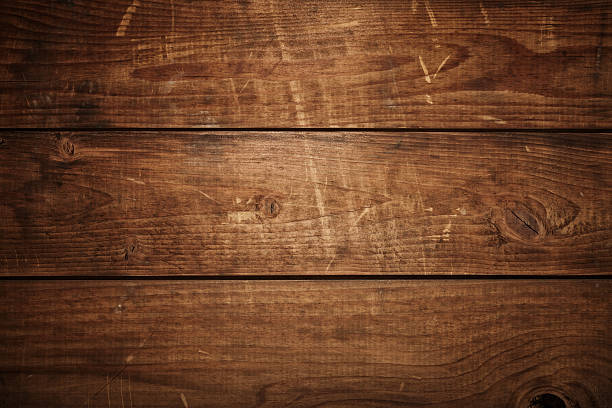 Overhead view of old dark brown wooden table Overhead view of old dark brown wooden table workbench stock pictures, royalty-free photos & images