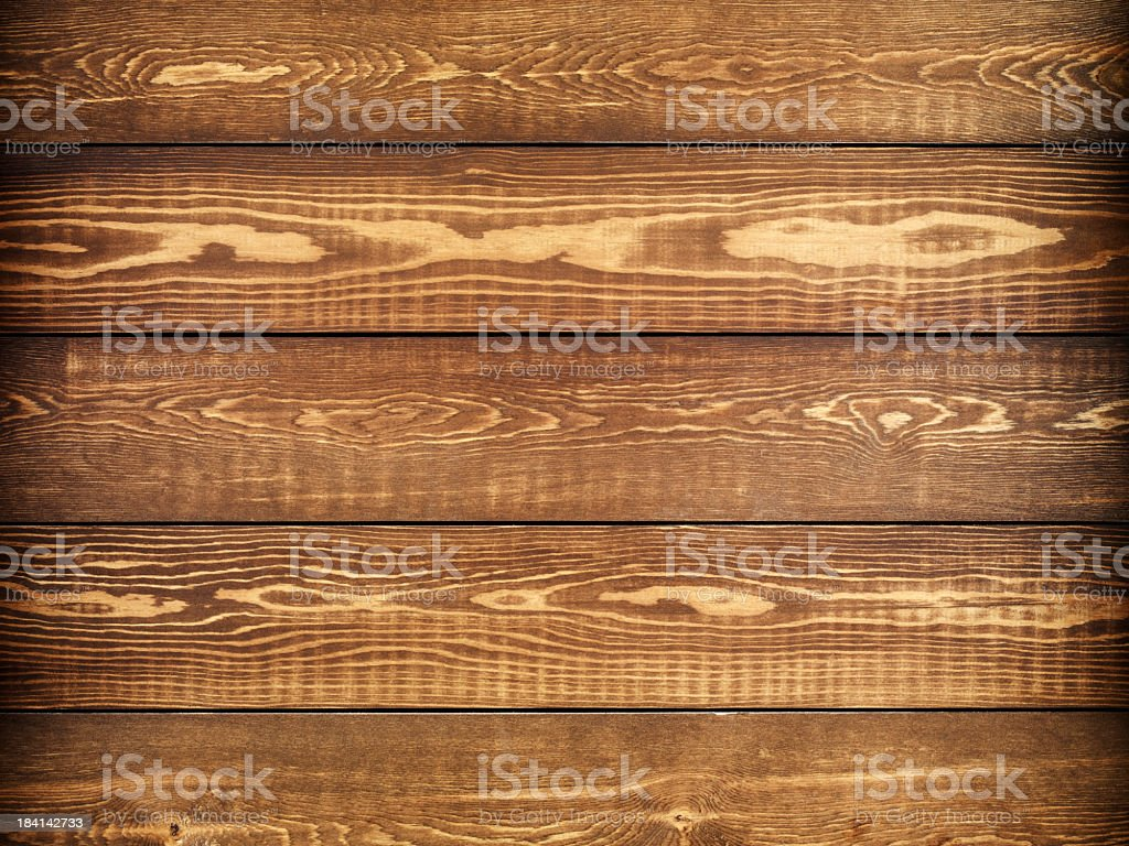 Overhead view of old dark brown wooden table royalty-free stock photo