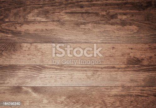 istock Overhead view of old dark brown wooden table 184295340