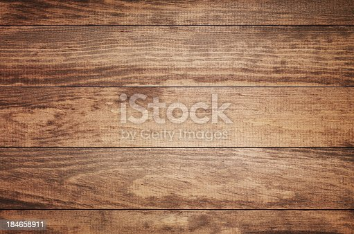 istock Overhead view of old dark brown wooden table 184658911