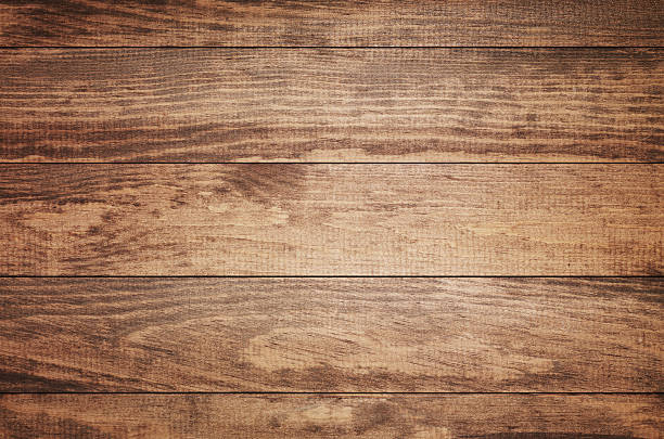 Overhead view of old dark brown wooden table stock photo