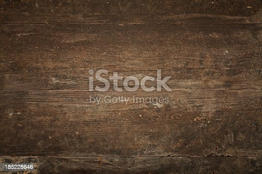 istock Overhead view of old dark brown wooden table 185228646
