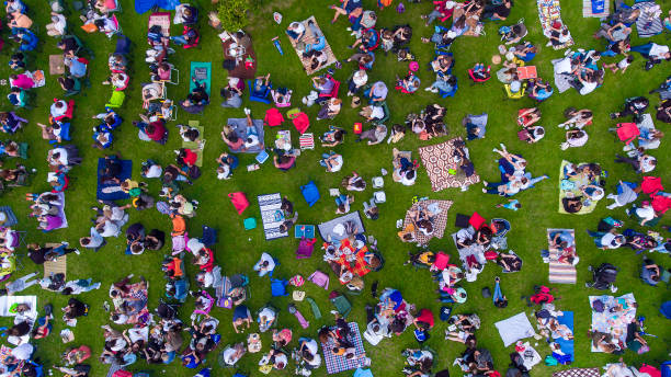 Overhead view of people in a city park on a summer day, sitting, standing, on picnic rugs in Ankara Turkey Aerial view of park drone point of view stock pictures, royalty-free photos & images