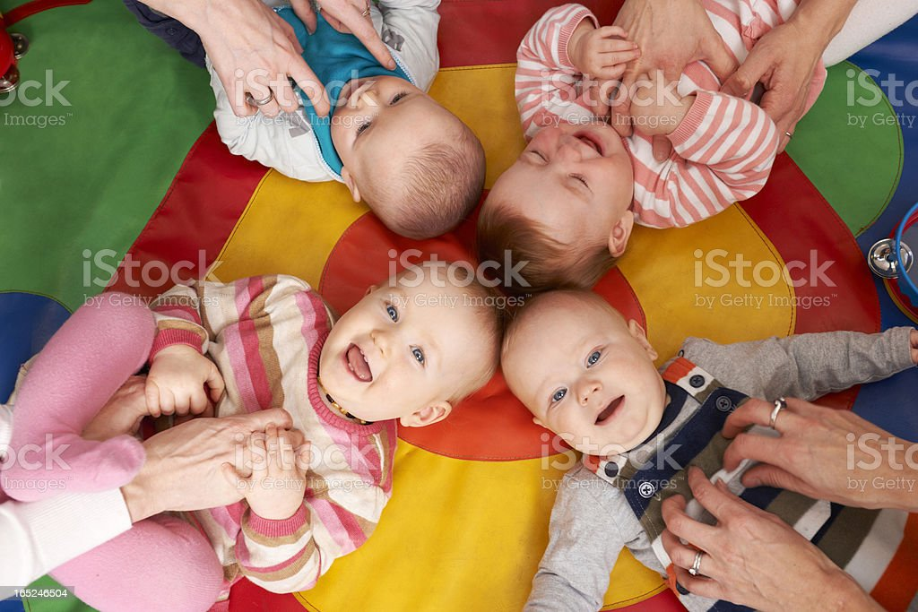 Overhead view of playing nursery babies royalty-free stock photo
