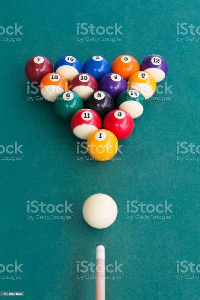 Overhead view of pool billards snooker balls on green table stock photo