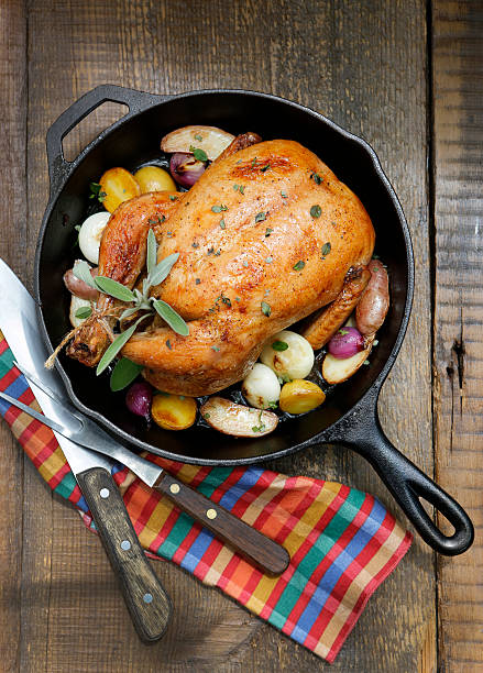 Overhead View of Roast Chicken with Vegetables and Sage.