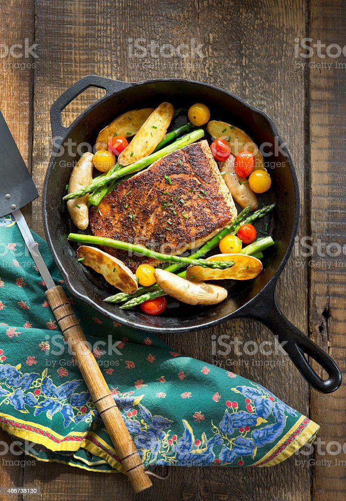 Overhead View of Roast Salmon and Vegetables in Cast-Iron Pan. stock photo