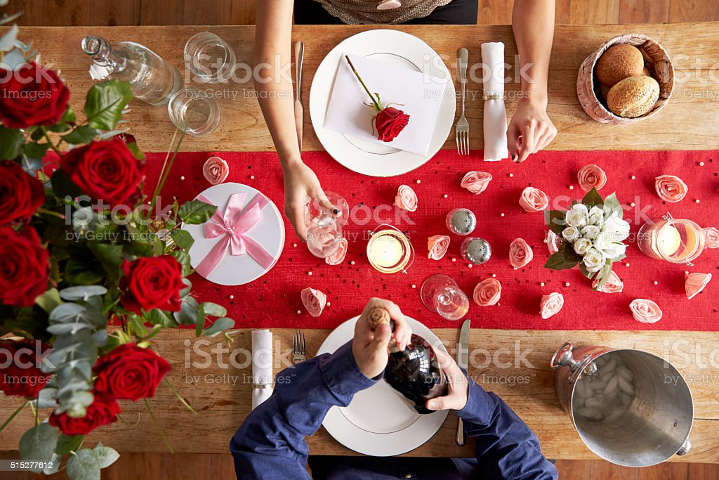 Overhead View Of Romantic Couple At Valentines Day Meal stock photo