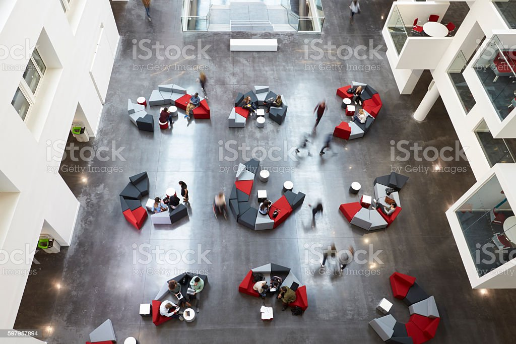 Overhead view of seating in a university atrium, motion blur stock photo