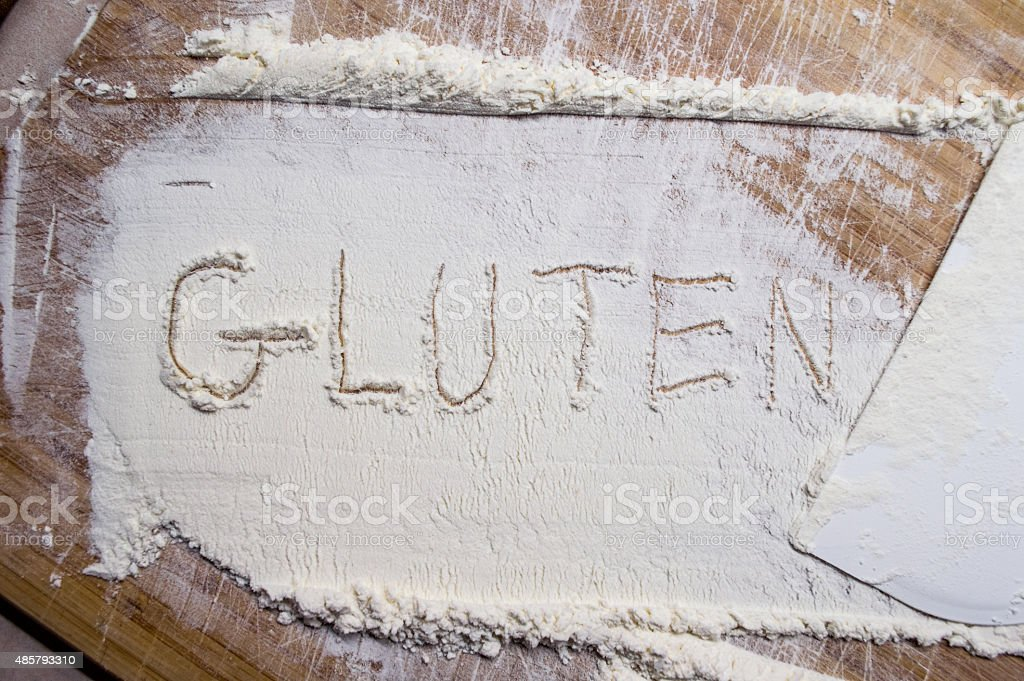 Overhead View of Spread White Flour with 'Gluten' Drawn stock photo