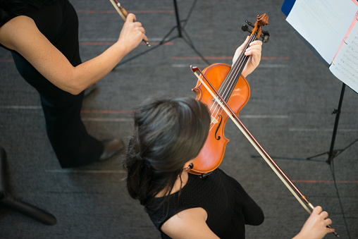 istock Overhead View of Student Violinists Performing at a Concert 1129790086