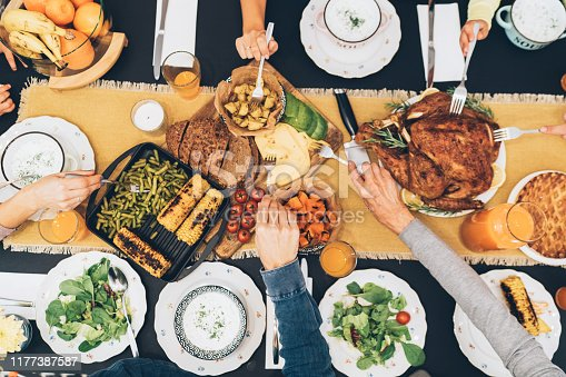 istock Overhead view of table during Christmas dinner 1177387587