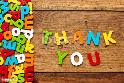 849181972istockphoto Overhead view of thank you arranged by alphabets on wood 849188332