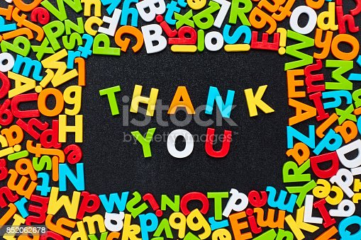 istock Overhead view of thank you text amidst colorful alphabets 852062678