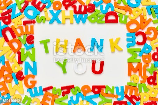 849191694 istock photo Overhead view of thank you text surrounded by alphabets 852119942