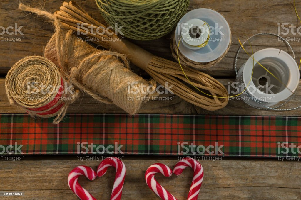 Overhead view of thread spools with candy cane stock photo