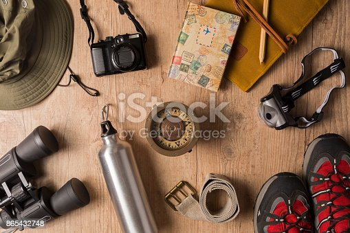istock Overhead view of travel equipment for a backpacking trip. 865432748
