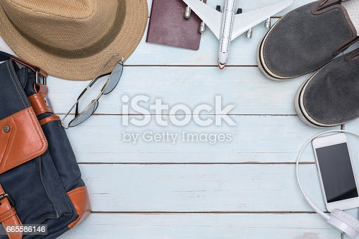 istock Overhead view of traveler accessories with copy space 665586146