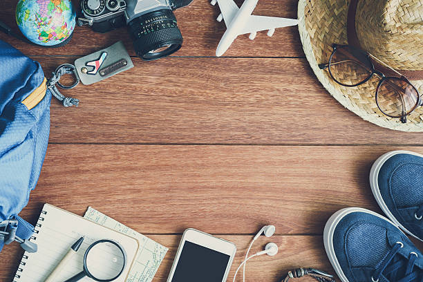 overhead view of traveler's accessories and items - travel imagens e fotografias de stock