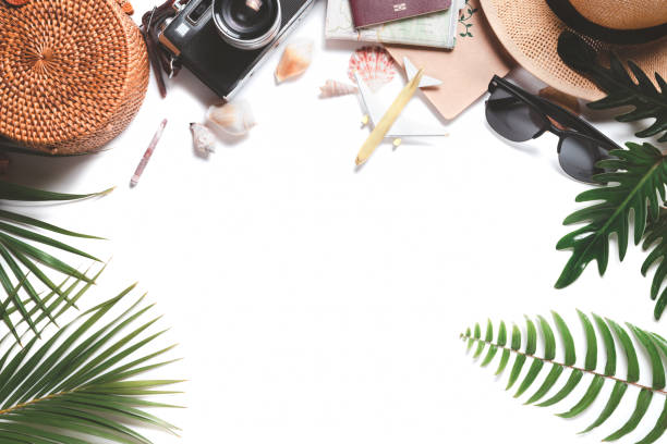 Overhead view of Traveler's accessories, vintage camera with hat and leaf stock photo