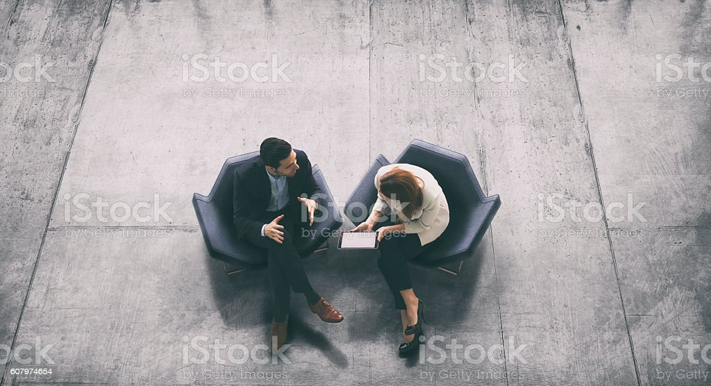 Overhead view of two business persons in the lobby