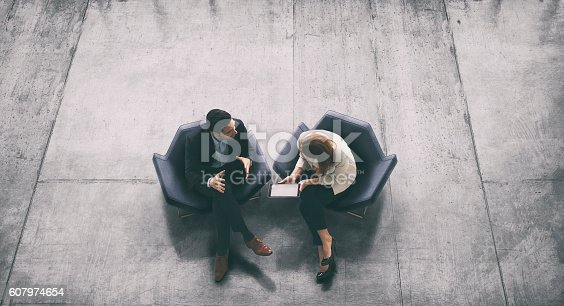 istock Overhead view of two business persons in the lobby 607974654