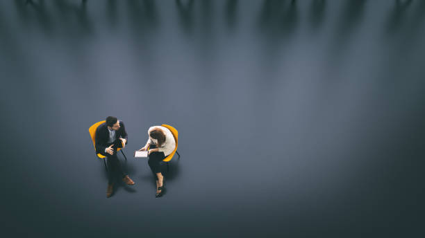 Overhead view of two business persons in the lobby - foto de stock