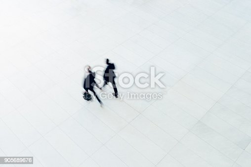 istock Overhead view of two businessman walking 905689676