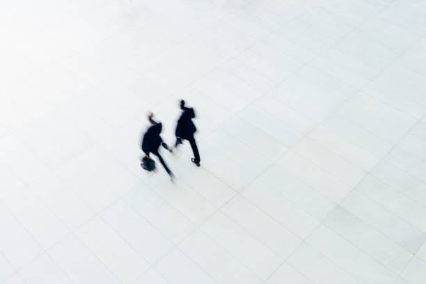 Overhead view of two businessman walking stock photo